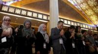 Relatives of passengers killed onboard flight MH17 pray during a memorial service