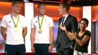 Olympic rowers standing next to Breakfast presenters