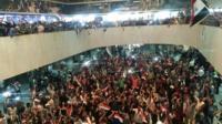 Big crowd waving flags