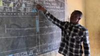 Richard Appiah Akoto and his chalkboard