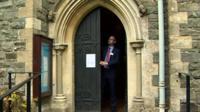 Doors shut at Holy Trinity Church in Llandrindod Wells, Powys