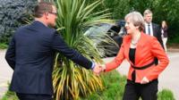 Theresa May shakes the hand of Conservative candidate for Wrexham Andrew Atkinson