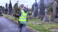 A man working at a cemetery