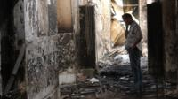 An employee of Doctors Without Borders walks inside the charred remains of their hospital after it was hit by a U.S. airstrike in Kunduz, Afghanistan, Oct. 16, 2015
