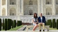 The Duke and Duchess of Cambridge pose on a bench at the Taj Mahal