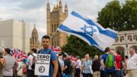 A man with an Israeli flag on Parliament square in London
