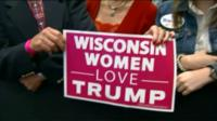 "Women hold up a 'Wisconsin women love Trump"" sign at a rally in Green Bay, Wisconsin - 18/10/2016"