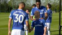 Danny shakes the hand of Everton players