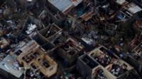 Aerial images show homes badly destroyed, some without roofs, in the southern town of Jeremie
