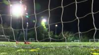 Goalkeeper standing in front of the net