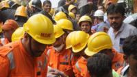Rescuers at the scene in Mumbai