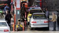 Iranians drivers refuel their vehicles at a gas station in the capital Tehran on January 19, 2016