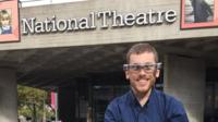 Ellis Palmer in smart captioning glasses outside the National Theatre in London