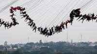 Thrill-seekers in Brazil have broken the unofficial world record for the most participants to take part in a bungee jump.