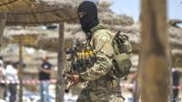 A member of Tunisia's special forces inspects the beaches