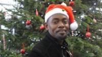 man wearing Christmas hat