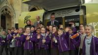 A group of kids with Michael Gove