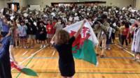 Japanese schoolchildren singing the Welsh national anthem