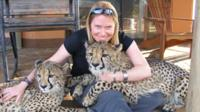 Dr Amy Dickman with two big cats
