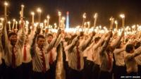 Volunteers take part in a torch-lighting performance at Kim Il-Sung square in Pyongyang on October 10