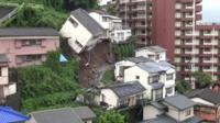 Japanese house toppling over following mudslide