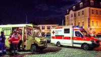 Emergency services are seen near a scene of a suicide attack in the southern German city of Ansbach