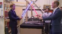Princes William and Harry duel with lightsabers