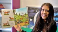 Teacher holds story book