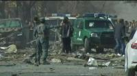 Afghan security forces rush to help the injured