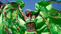 A reveler performs at the 'Carmelitas' block party during Carnival celebrations in Rio de Janeiro, Brazil, Friday, Feb. 5, 2016.