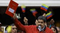 """Venezuela""""s President Nicolas Maduro holds a document with the details of a """"constituent assembly"""" to reform the constitution during a rally at Miraflores Palace in Caracas, Venezuela May 23, 2017."""