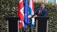 The UK prime minister did not attend a planned press conference in Luxembourg after protesters gathered outside.