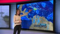Louise Lear stands in front of BBC Weather map which shows Hurricane Matthew