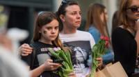 People pay their respects to Manchester attack victims