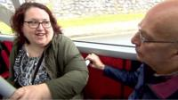 Passengers chatting on a bus in Plymouth