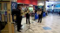 Members of the Ulster Orchestra perform at Europa Bus Station, Belfast, 28 September 2016