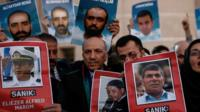 "Family members hold photos of victims of the Mavi Marmara ship, the lead boat of a flotilla headed to the Gaza Strip, and three suspected Israeli commanders who stormed the vessel in a predawn confrontation, outside the city""s main courthouse after the trial in Istanbul, Friday, 9 December 2016."