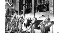 File photo from 1993 - officers search for survivors in wreckage of Bombay Stock Exchange in Mumbai, India