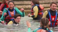 School pupils learning how to stay safe around water.