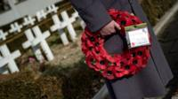 A British Royal officer holds a wreath of poppies at the French soldiers' cemetery in Belgrade