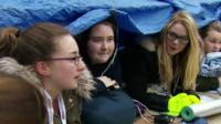 students under tent