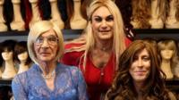 Transgender women trying on wigs