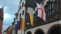 EU and German flags flying outside Freiburg town hall.