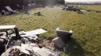 A huge quantity of debris and waste has been dumped on farmland near an M1 junction near Luton.
