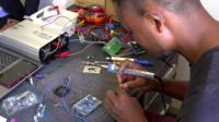 A worker assembling electrical components