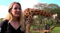 Ellie Goulding with a giraffe in the background