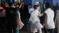 Supporters of Nigeria's President Muhammadu Buhari celebrate in Abuja