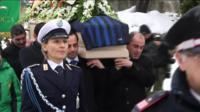 Mourners carry the coffin of Italian avalanche victim Alessandro Giancaterino