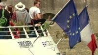 French and EU flags on boat