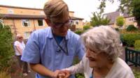 Krastan Antonov helping a care-home resident